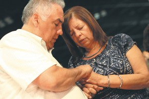 Luis and Gloria Burgos of St. John Neumann Church, Lilburn, pray together during the healing service that followed the opening Mass.