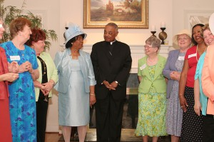 In a 2007 photo Archbishop Wilton D. Gregory checks with Atlanta Archdiocesan Council of Catholic Women president May Fern Barron, left center, to make sure he has covered everything she wanted him to say to the assembly  of women at his residence for the annual brunch. Photo By Michael Alexander