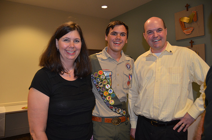 Joshua Forbes received his Eagle Scout award in a Court of Honor ceremony Aug. 17. His parents, Cecilia and John, parishioners at Holy Cross Church, Atlanta, were on hand for the ceremony.