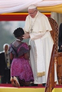 Pope Francis embraces Winnie Nansumba, who was born with and is living with HIV, during a meeting with young people at the Kololo airstrip in Kampala, Uganda, Nov. 28. Nansumba, 24, is involved in advocating for other people living with HIV/AIDS and in the fight against the spread of the disease. CNS photo/Paul Haring