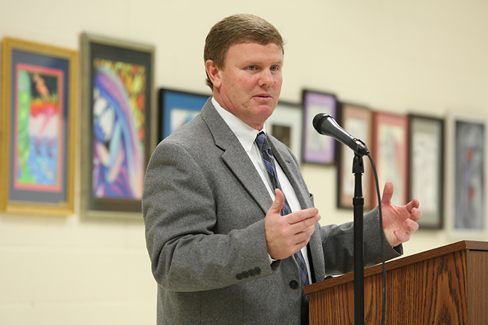 Blessed Trinity High School athletic director Ricky Turner opens the Athletic Hall of Fame induction ceremony. The project was two years in the making. Photo By Michael Alexander